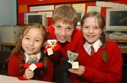 KNIT THREE: (l-r) Ellie Holcombe, nine, Sam Rogers, ten and Jessica Thompson, nine with finished Burundi Bears