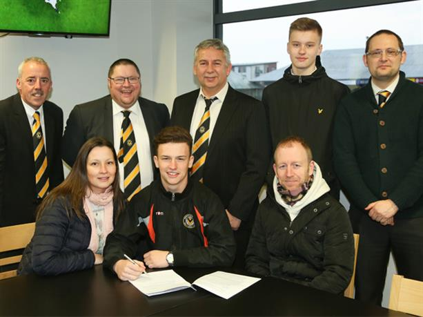SIGNED: New Newport County professional Liam Angel with family and board members. Picture: Davies Sport Photgraphy