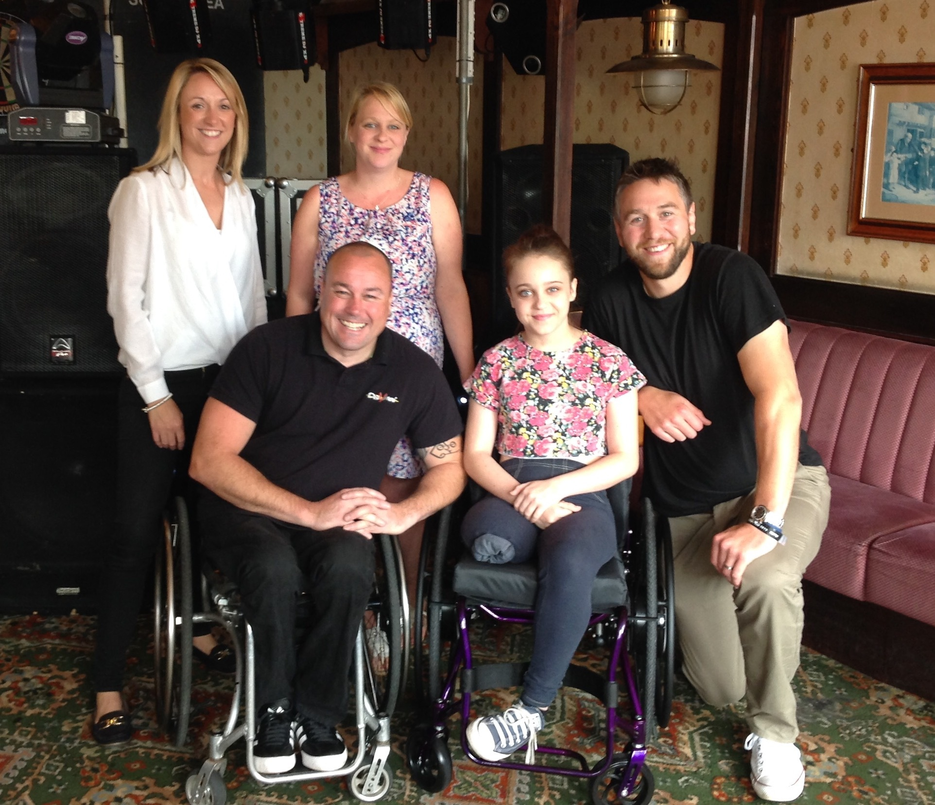 (Back, L to R) Princes Gate commercial director Samantha Atkinson, Lyndsey Leigh. (Front, L to R) Paralympian Richie Powell, Tia Leigh and Ryan Jones