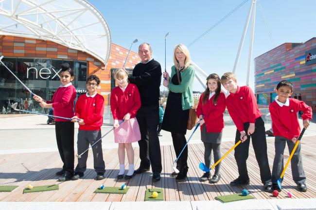 STREET GOLF: Mark Mouland with Victoria Holloway, marketing & PR manager for Queensberry Real Estate, and some of the children who took part in the event. Picture: Matthew Horwood