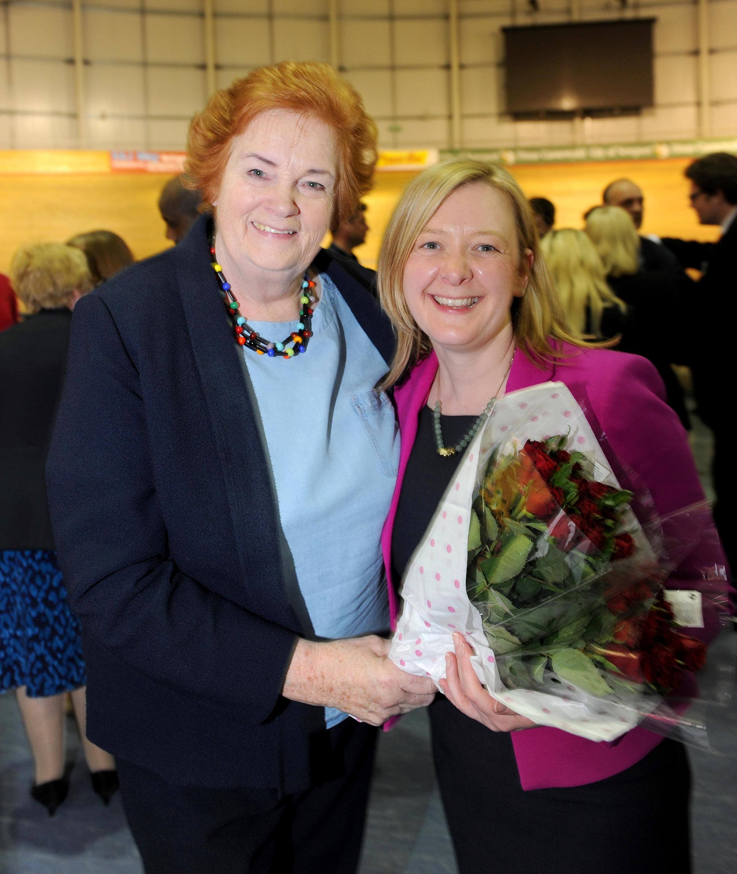 Dame Rosemary Butler, left, congratulating her replacement Jayne Bryant