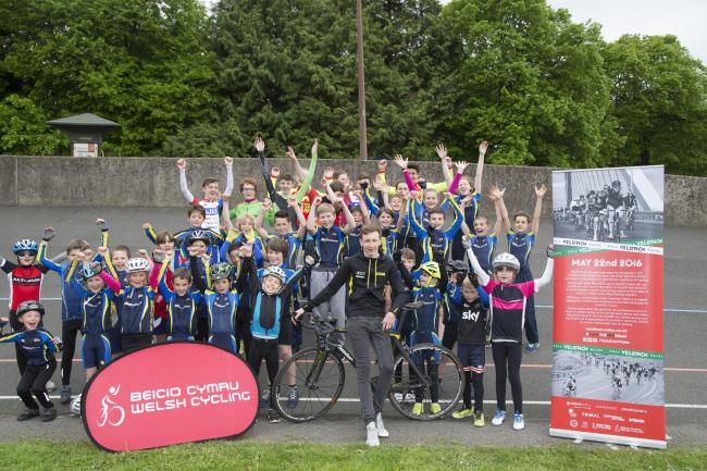 EXCITED: Newport-based cyclist Stephen Williams of JLT Condor with Maindy Flyers Mini League members
