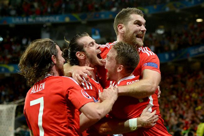 TOGETHER: Wales players celebrate Sam Vokes' goal to finish off Belgium in the Euro 2016 quarter-final