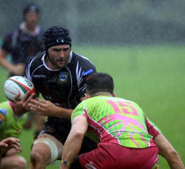 South Wales Argus: Bedwas' James Richards takeson Pontypridd's Aled Summerhill
