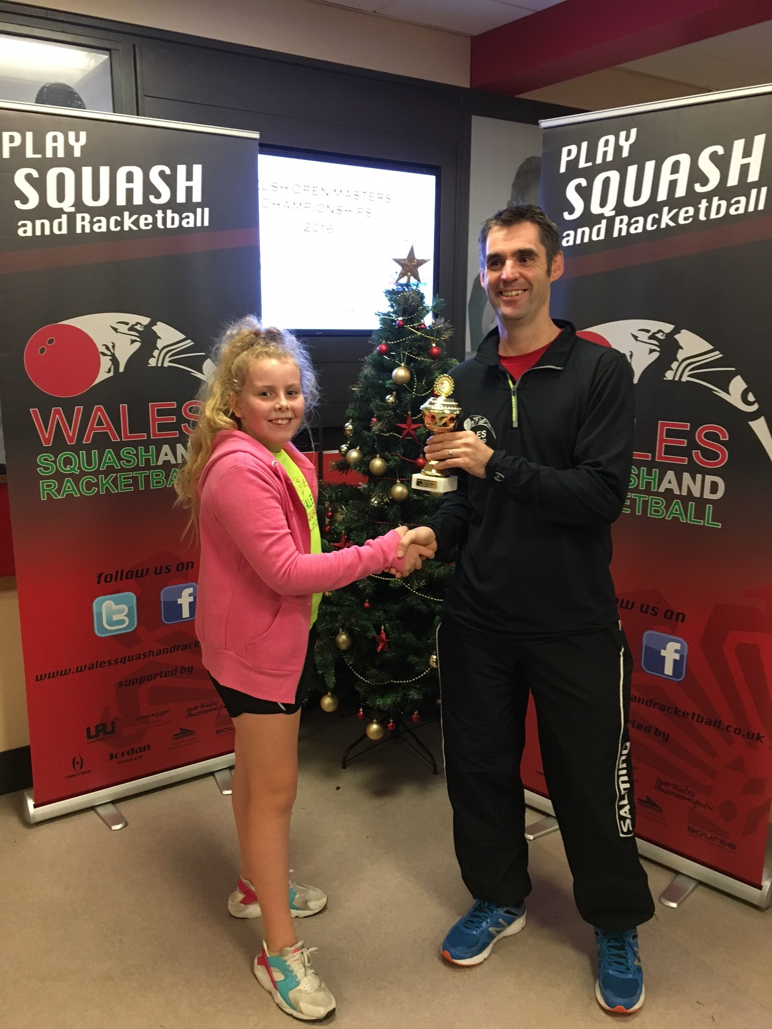 SUCCESS: Newport's Eve Griffiths with coach Greg Tippings and her runner-up trophy from the Welsh Championships