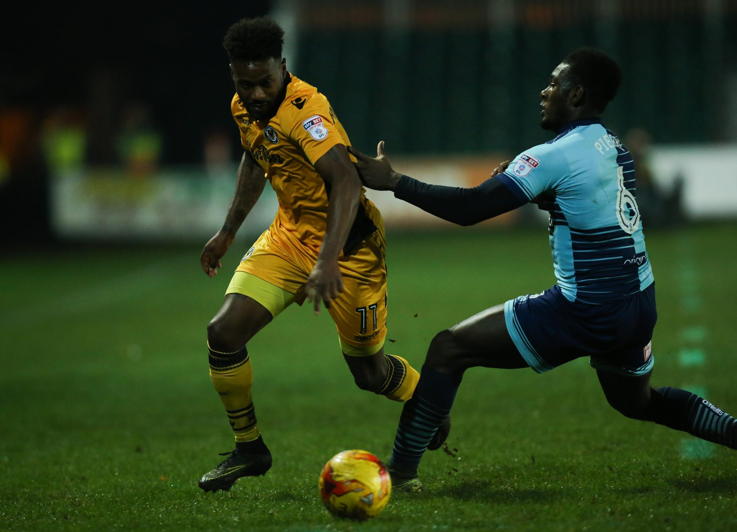 DEFENSIVE DUTIES: Jennison Myrie-Williams, left, impressed at left-back against Morecambe
