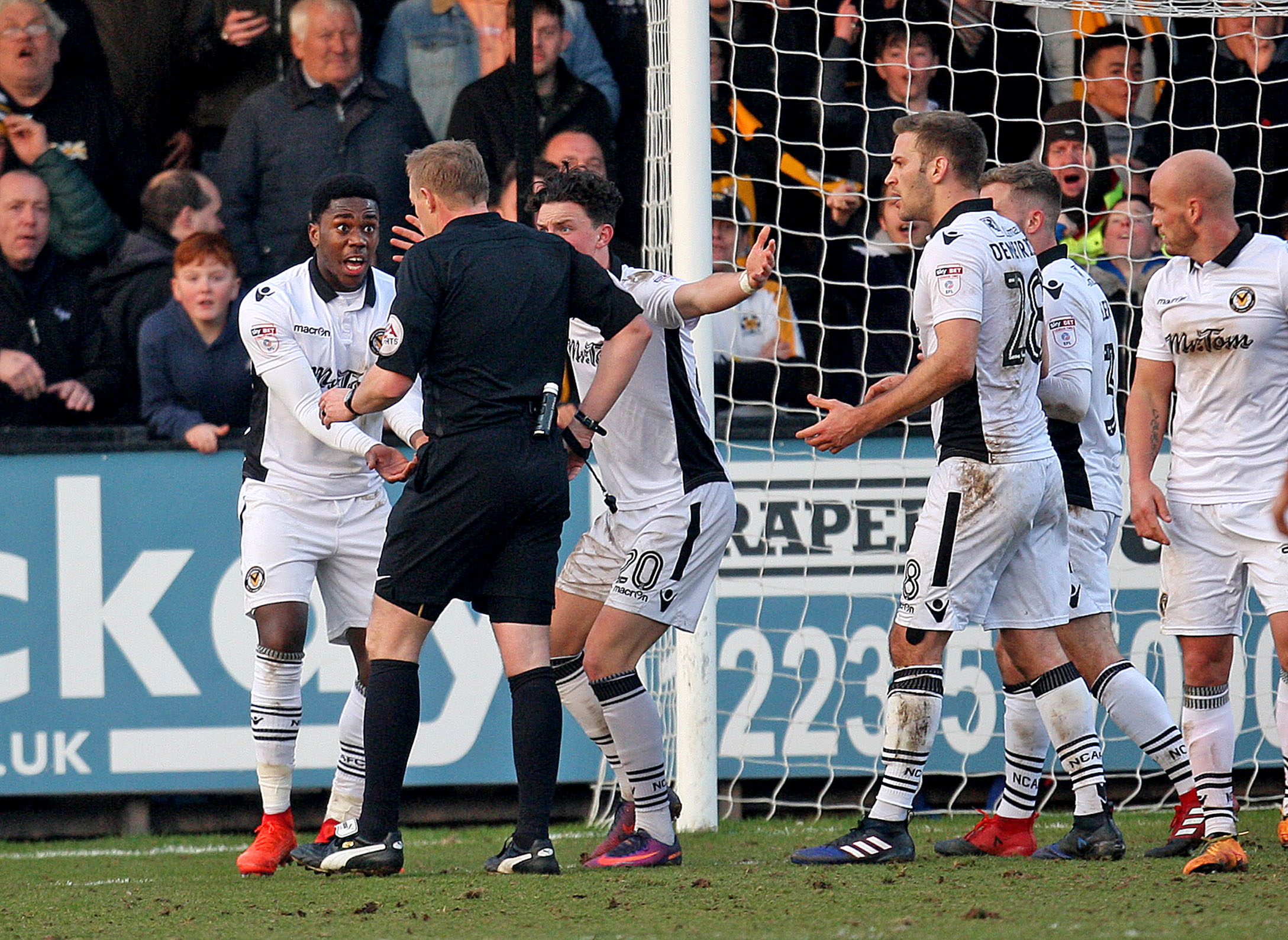 DISBELIEF: Newport County midfielder Mitch Rose protests his innocence to referee Trevor Kettle at Cambridge United on Saturday. Picture: Huw Evans Agency