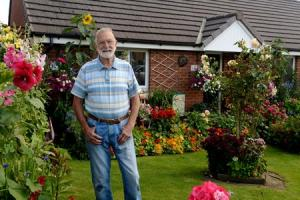 Mr Les Guy has won 1st place in the Newport in Bloom awards for his front garden. Pictured is Les in his award winning front garden..