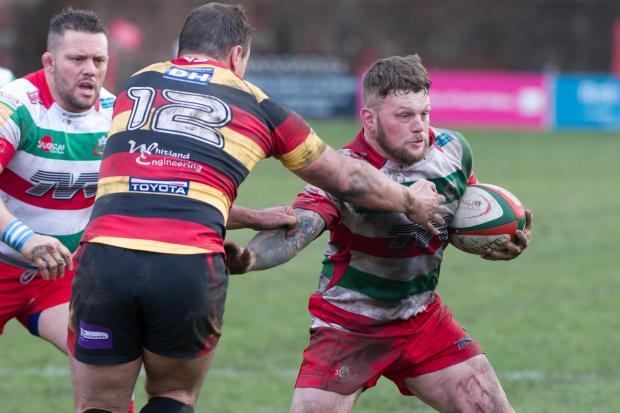 South Wales Argus: ON THE RUN: Flanker Ronny Kynes goes on the charge against Carmarthen Quins in Ebbw's November win