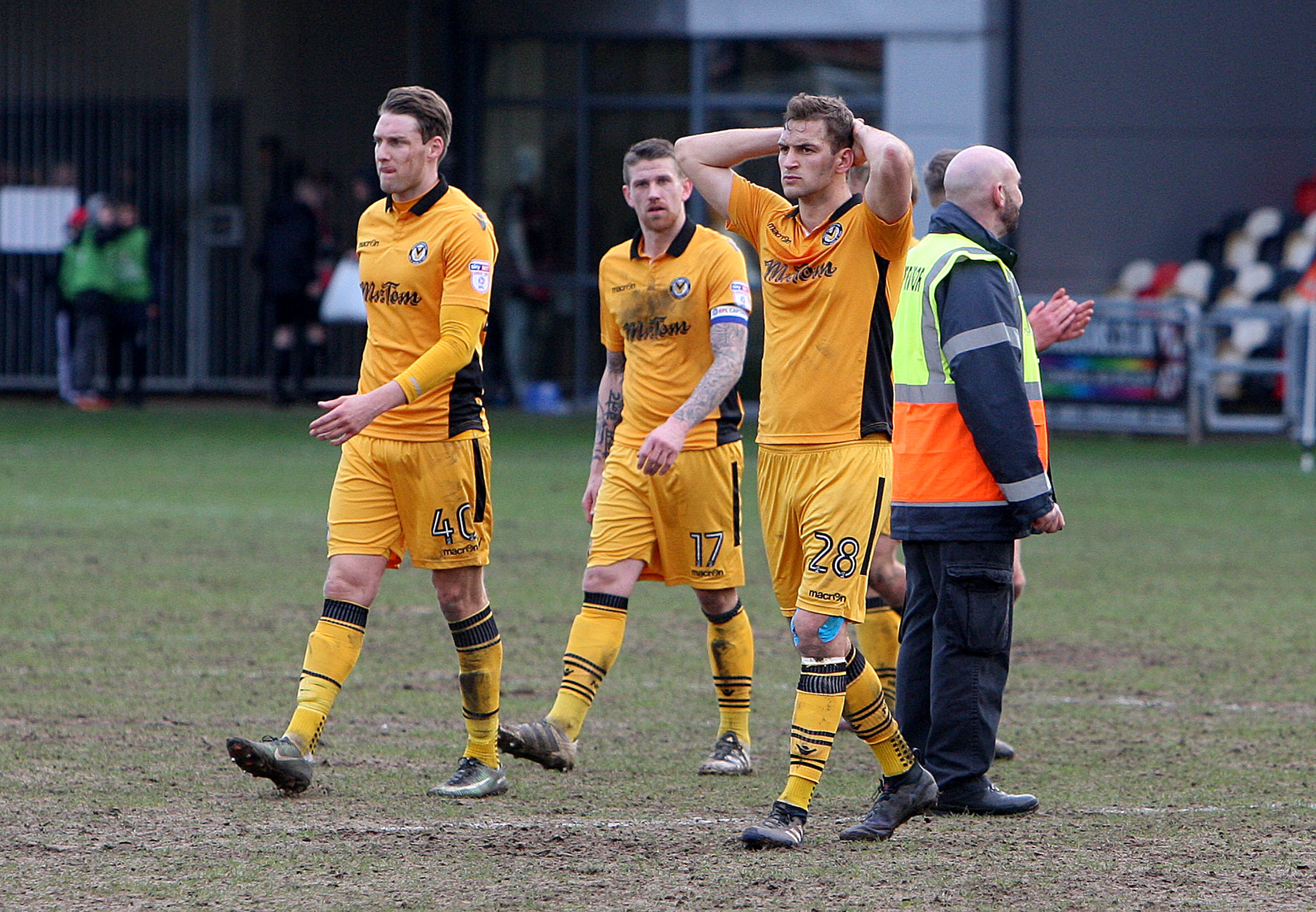 BEATEN: Newport County players react after the 4-0 defeat to Leyton Orient. Picture: Huw Evans Agency