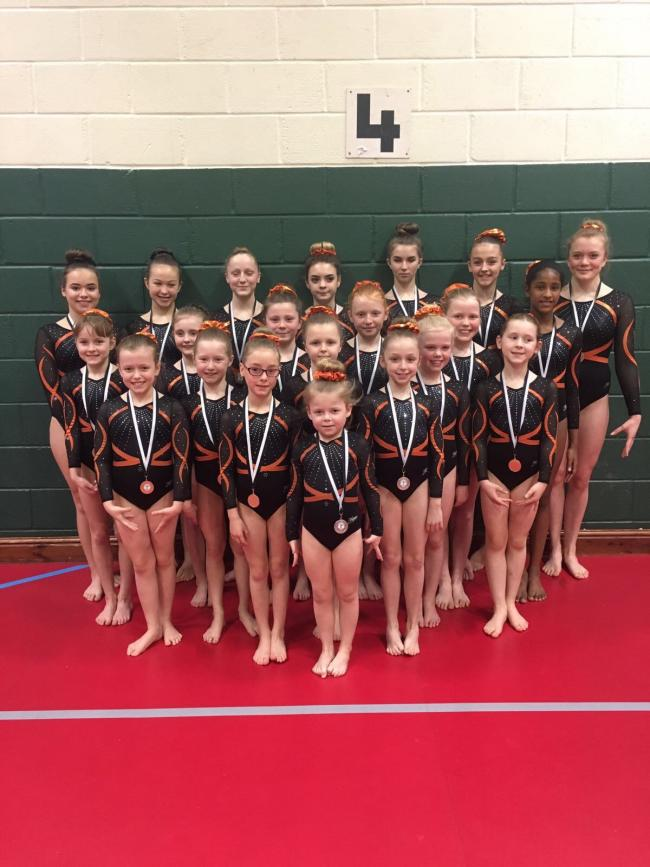 The competitive acrobatic squad from Wye Gymnastics with their latest haul of medals