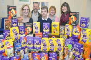 Egg doanation. Noah Herniman has donated over 90 Easter eggs to Womens Aid in Newport. L-R Emily Greenwood, Nigel, Noah and Shelley Herniman and Lowri Smith