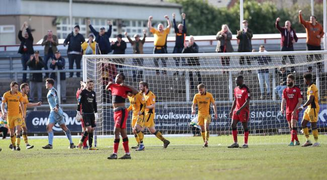 RELIEF: Newport County fans celebrate along with the team at the final whistle. Picture: Huw Evans Agency