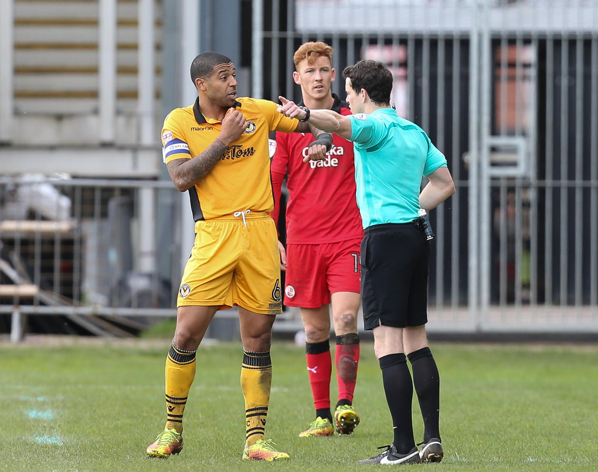 OFF: Joss Labadie is dismissed by referee Darren England during last Saturday's clash with Crawley
