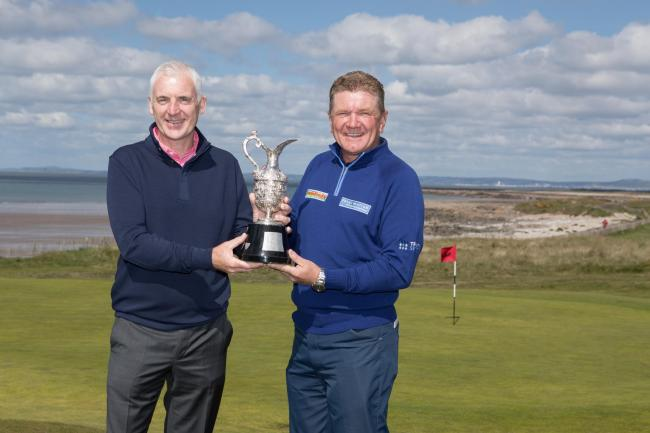 RIVALS: Phillip Price, left, and defending champion Paul Broadhurst with The Senior Open trophy at Royal Porthcawl. Picture: Steve Pope - Sportingwales