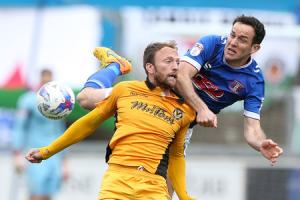 CONTEST: Luke Joyce of Carlisle United battles with Sean Rigg of Newport County. Pictures: Huw Evans Agency