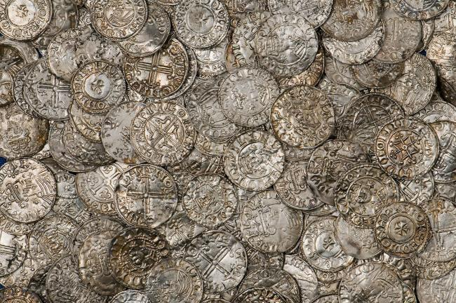 Coins from 1066 found in Abergavenny are among UK's top treasures.
