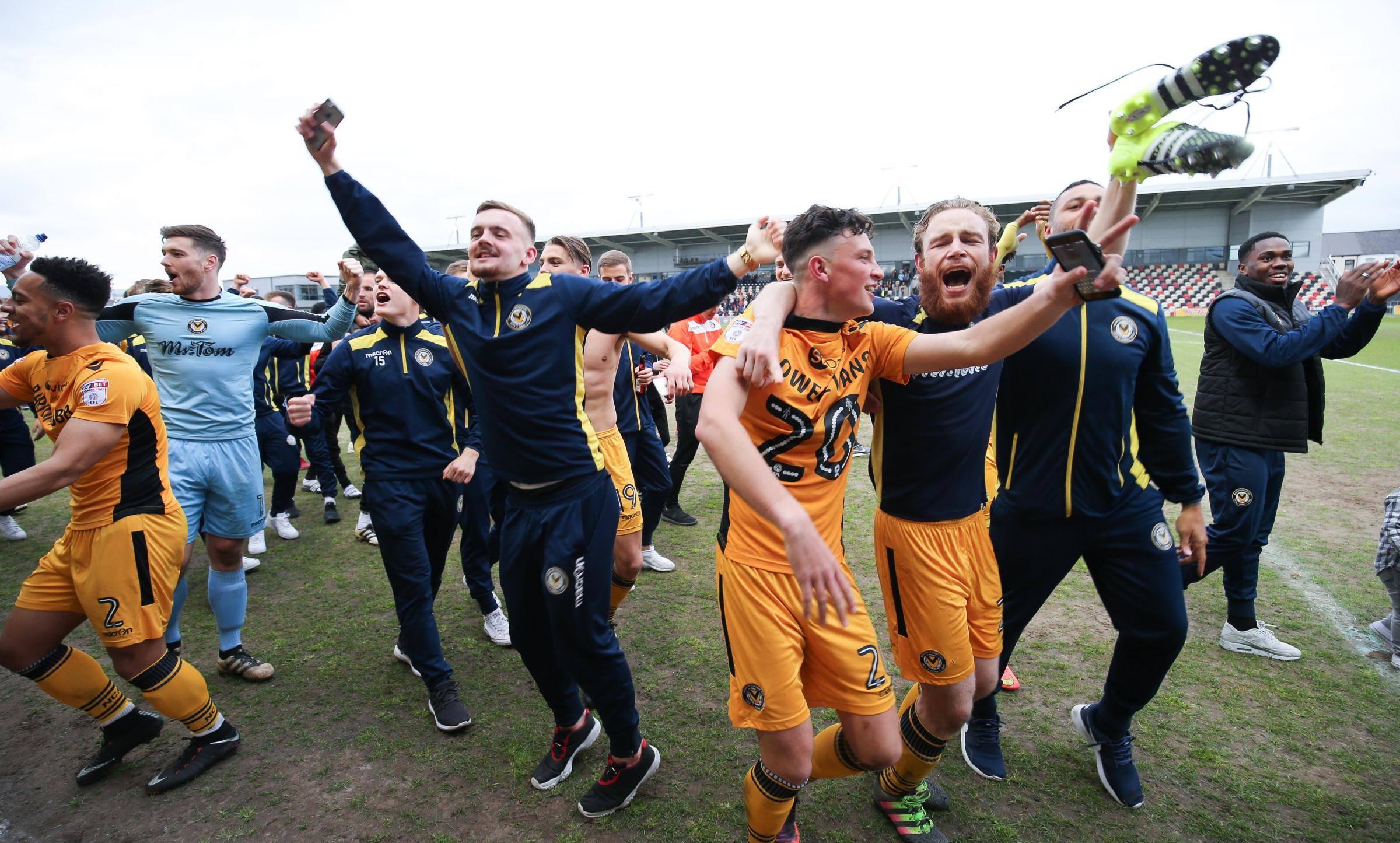 JOY: The Newport County players, including goal hero Mark O'Brien, right, celebrate after the final whistle. Picture: Huw Evans Agency