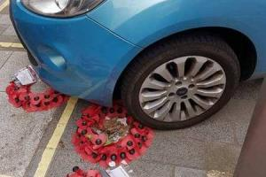 A car parked on a war memorial on the High Street