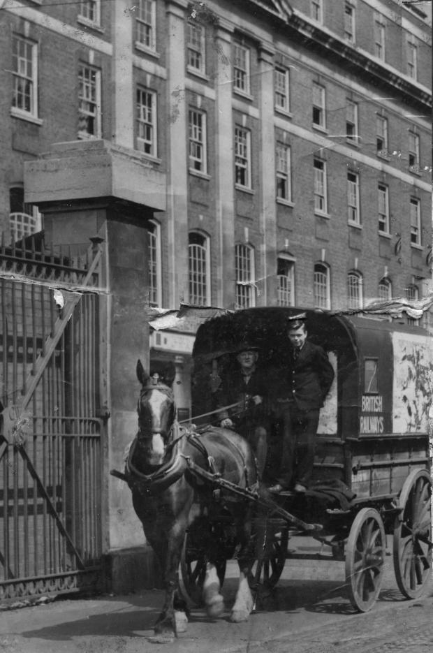 South Wales Argus: LAST DAY: Malcolm Thomas and Albert Tanner on the last horse and cart to deliver parcels from Newport station