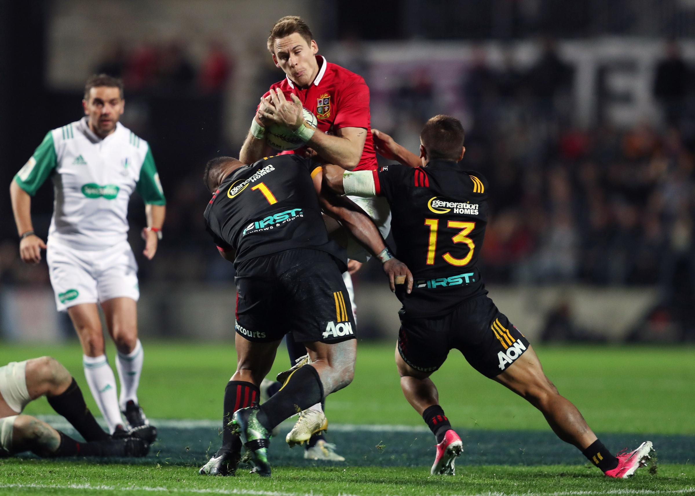 British and Irish Lions' Liam Williams is tackled by Chiefs Sigfried Fisiihoi and Tim Nanai Williams during the tour match at the FMG Stadium, Hamilton. PRESS ASSOCIATION Photo. Picture date: Tuesday June 20, 2017. See PA story RUGBYU Lions. Photo cre