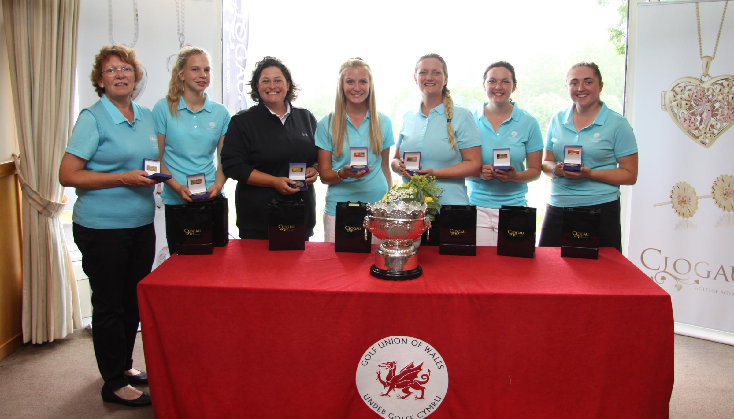 HAT-TRICK HEROES: Newport's players celebrate their third successive Welsh Ladies Team Championship