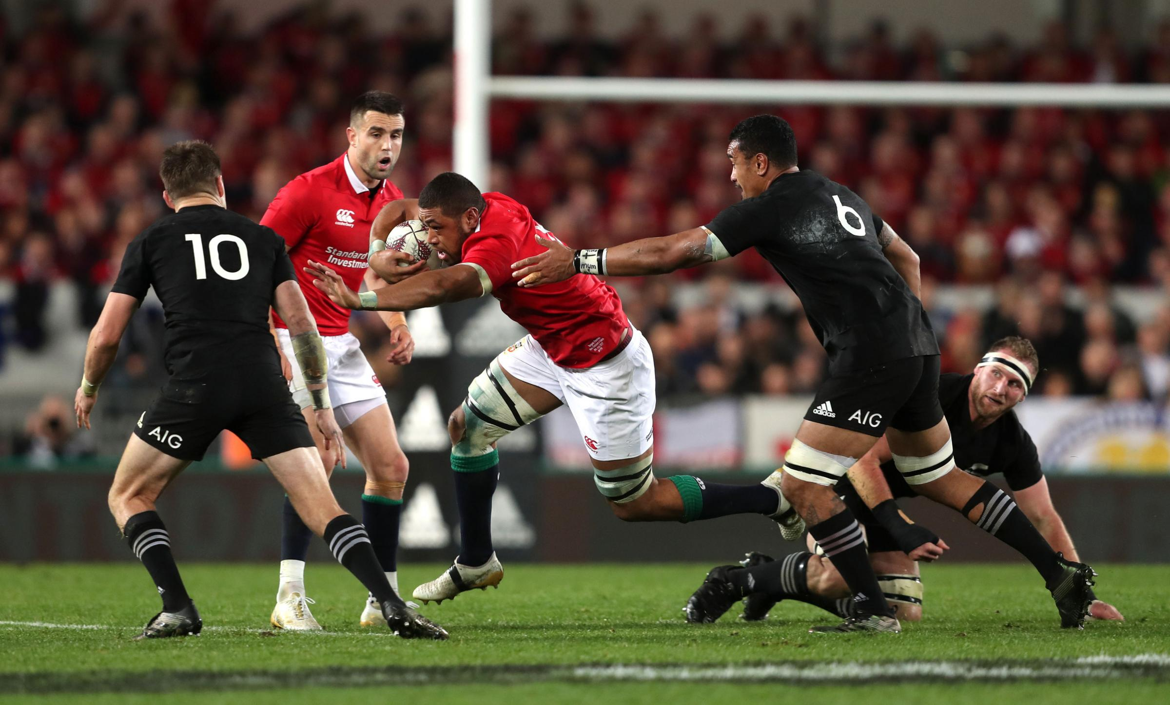 ON THE RUN: Lions number eight Taulupe Faletau tries to evade New Zealand's Jerome Kaino during the third Test