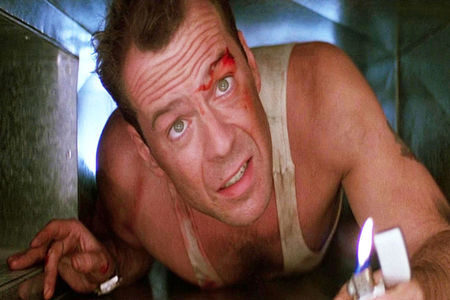 Film fans are watching Die Hard in a market this evening