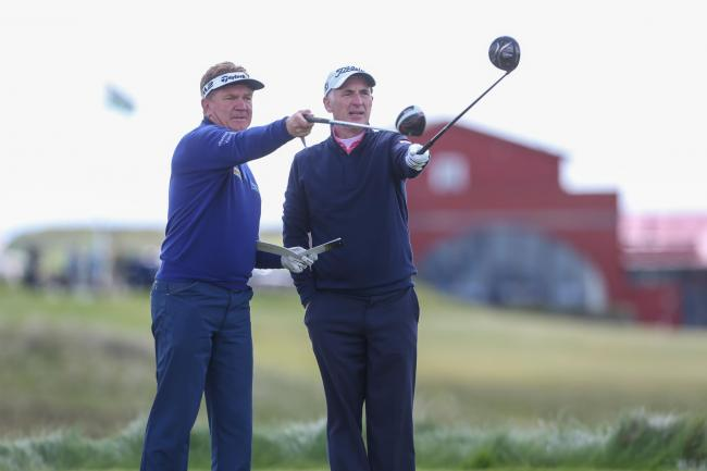 RIVALS: Newport's Phillip Price, right, with defending Senior Open champion Paul Broadhurst at Royal Porthcawl. Picture: Steve Pope - Sportingwales