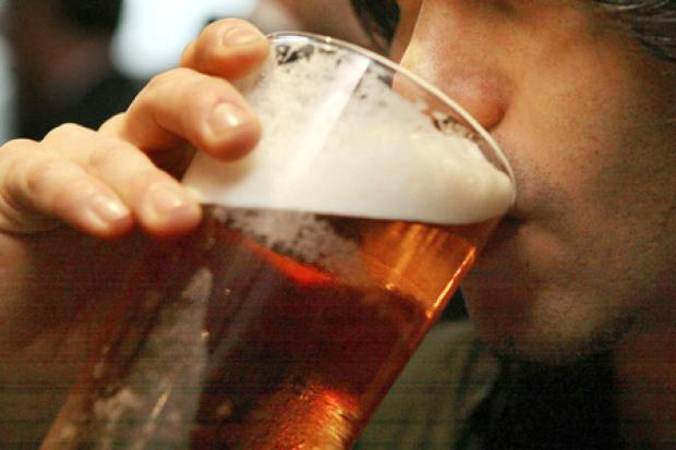 File photo dated 01/12/06 of a man drinking a pint of beer. Alcohol is more dangerous than illegal drugs like heroin, ecstasy and crack cocaine, according to a new study. PRESS ASSOCIATION Photo. Issue date: Monday November 1, 2010. Researchers rated alco