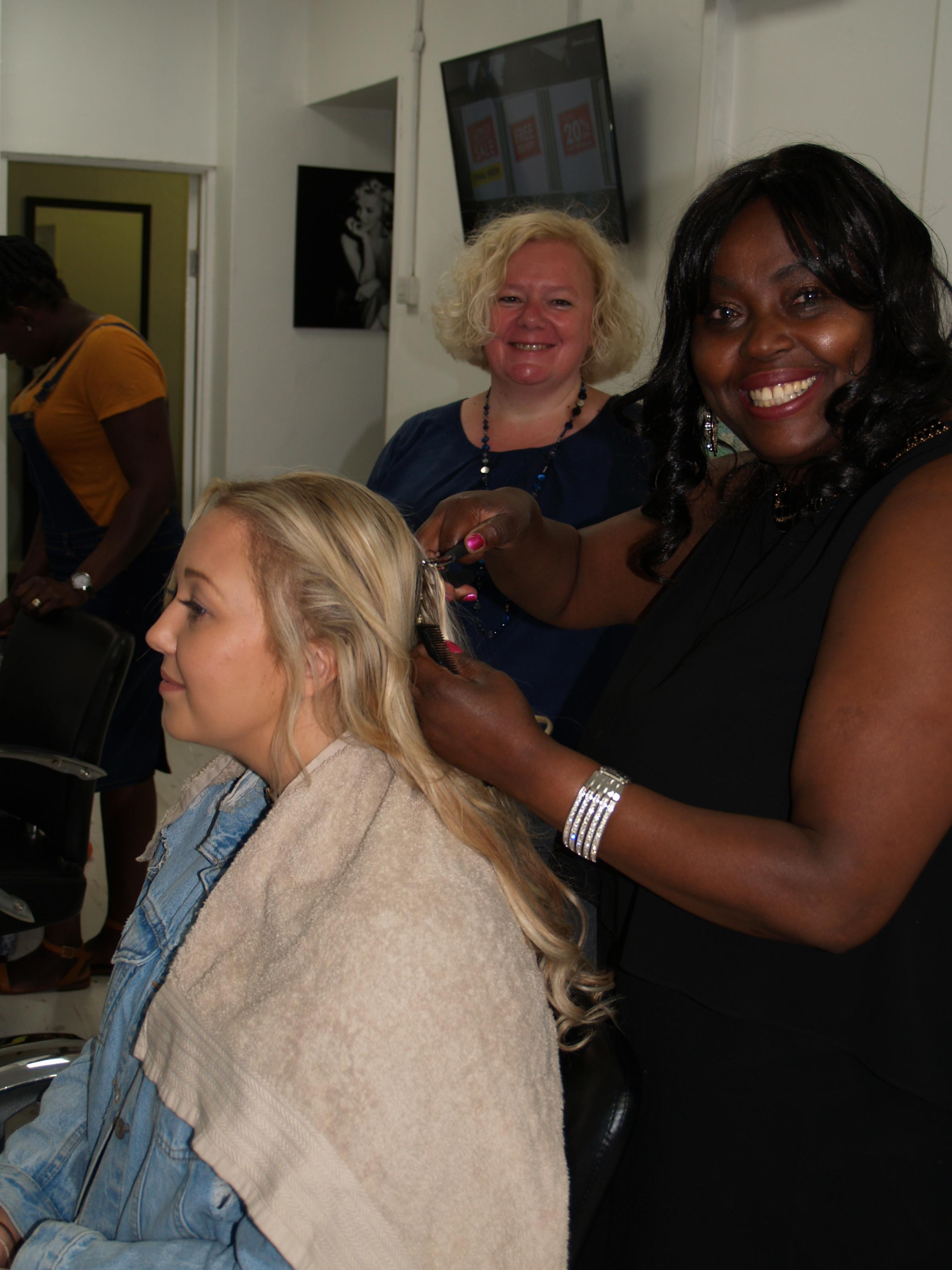 Christine Naluggwa, of Glossy Locks, in Newport city centre with Cllr Jane Mudd, of Newport City Council