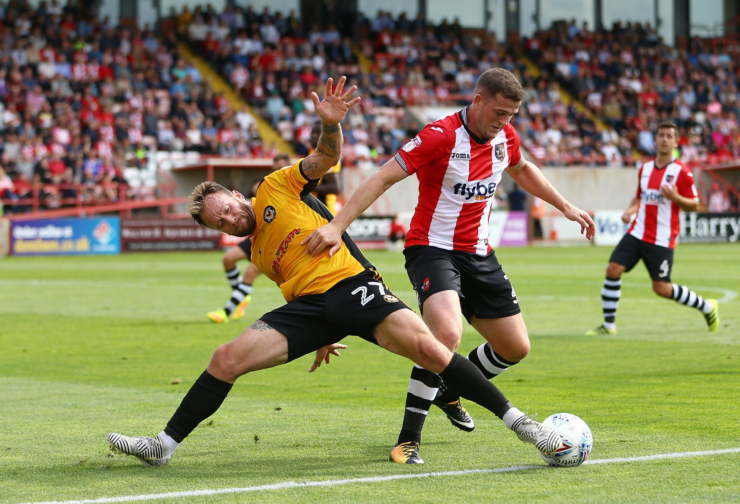 BATTLE: Newport County's Sean Rigg fights for the ball with Pierce Sweeney of Exeter City. Picture: Huw Evans Agency
