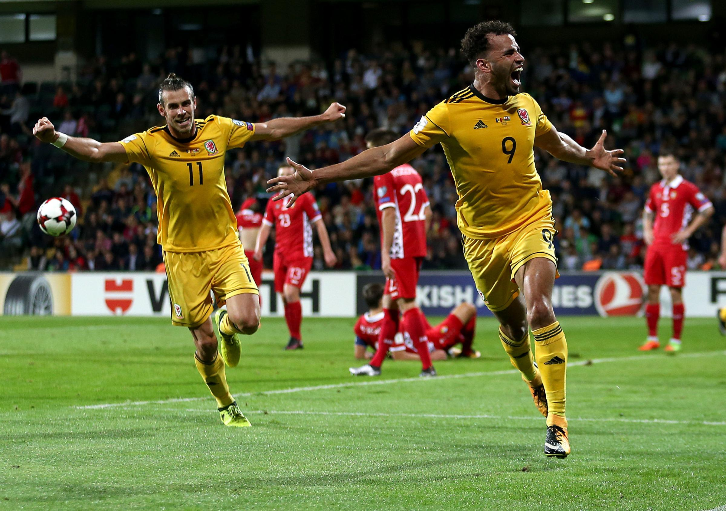 BREAKTHROUGH: Wales striker Hal Robson-Kanu, right, celebrates his goal in Moldova