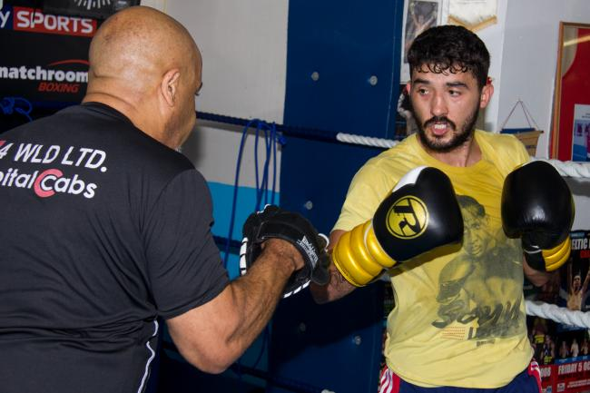 GOING FOR GLORY: Andrew Selby (right) in training with coach Tony Borg. Picture: www.liamhartery.com