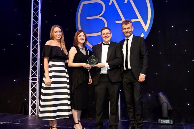L-R_ Katie Williams, Leanne Flanagan & Barrie Kenyon (Green & Co) with awards host Hugh Dennis