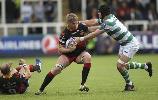 South Wales Argus: SHOCK CALL-UP: Aaron Wainwright carries the ball for the Dragons at Newcastle in the European Challenge Cup