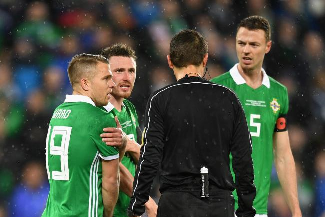 BELFAST, NORTHERN IRELAND - NOVEMBER 09:  Northern Ireland players contest the referees decision after he awards a penalty to Switzerland during the FIFA 2018 World Cup Qualifier Play-Off: First Leg between Northern Ireland and Switzerland at Windsor Park