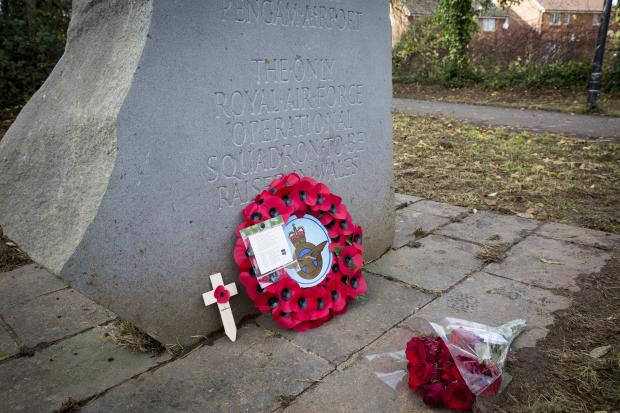 South Wales Argus: TRIBUTES: Poppies and flowers left at the squadron memorial at Pengam