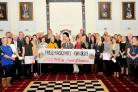 HAPPY: All the groups stood with provincial grandmaster Richard Davies and other freemasons