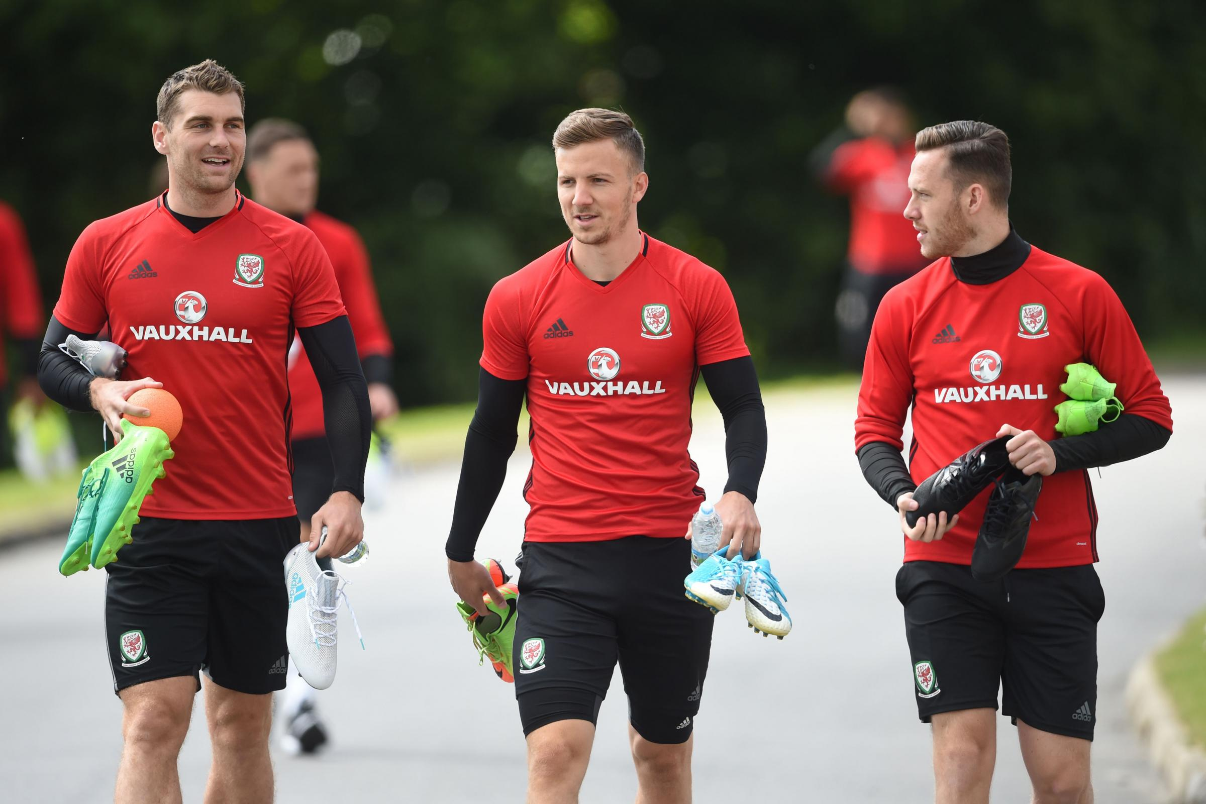Wales' (left to right) Sam Vokes, Lee Evans and Gethin Jones during the training session at The Vale Resort, Hensol. PRESS ASSOCIATION Photo. Picture date: Wednesday June 7, 2017. See PA story SOCCER Wales. Photo credit should read: Joe Giddens/PA Wir