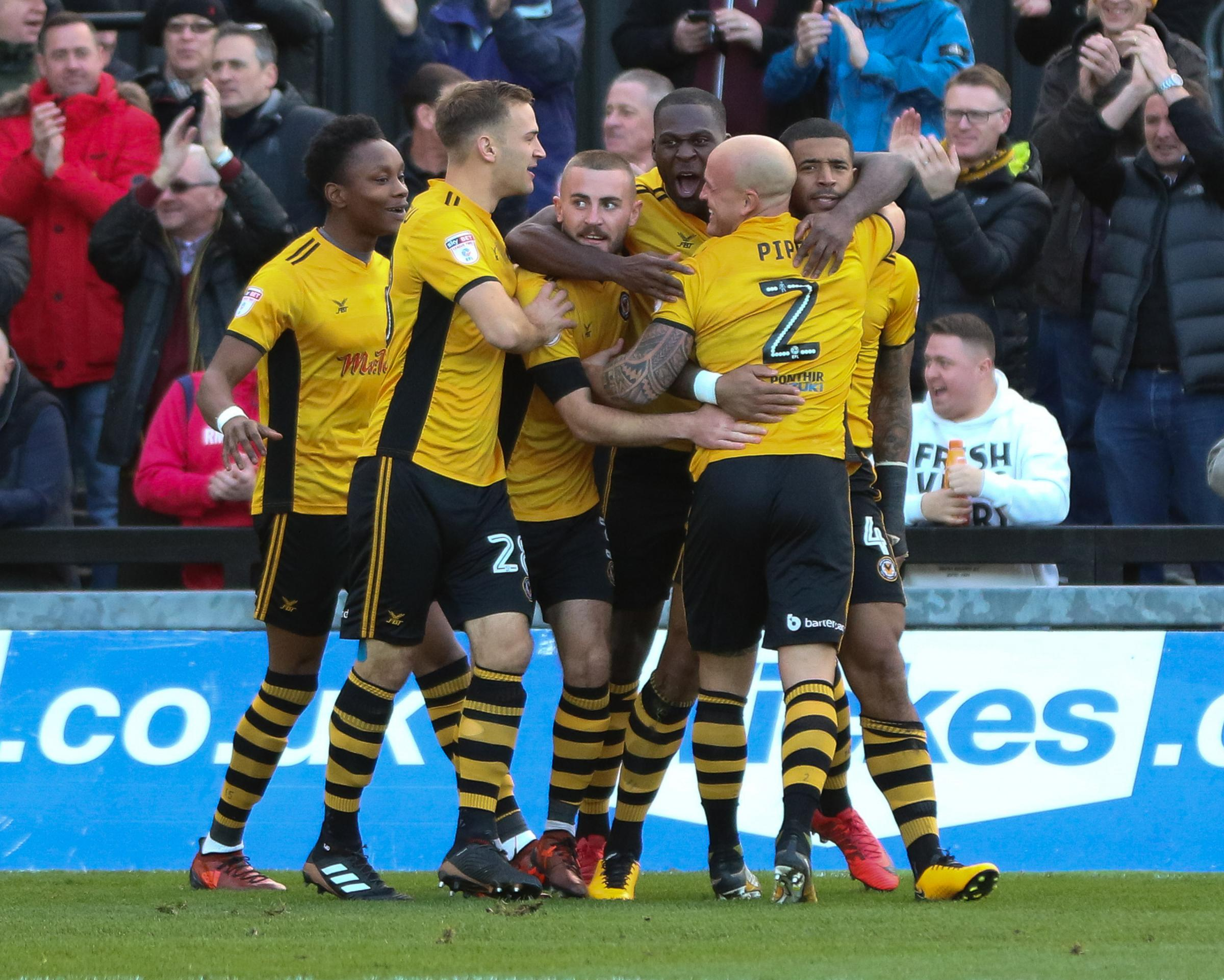 JOY: Newport County celebrate Joss Labadie's first goal against Cambridge United on Sunday. Pictures: Huw Evans Agency