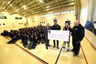 DONATION: Leon Brown and Bernard Jackman handed over a £500 cheque to St Joseph's High School