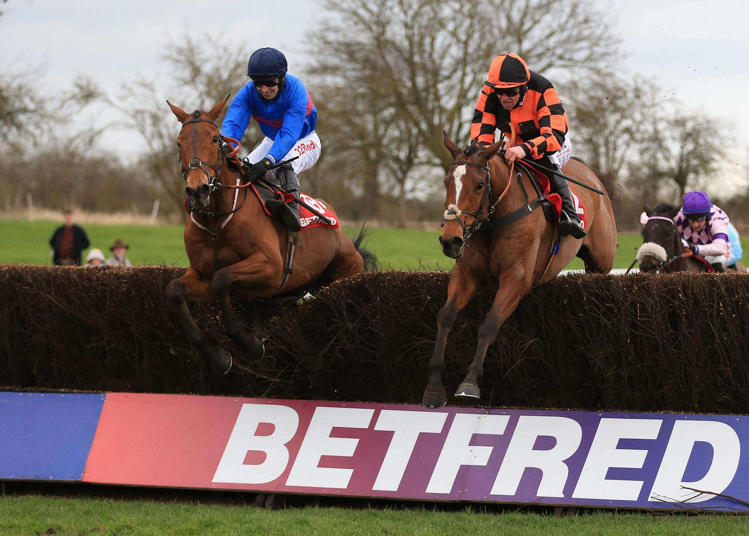 Chase The Spud (left) ridden by Paddy Brennan goes onto wins The Betfred Midlands Grand National (an open handicap steeple chase) ahead of Mystree ridden by Robert Dunne in second  at Uttoxeter Racecourse. PRESS ASSOCIATION Photo. Picture date: Saturday M