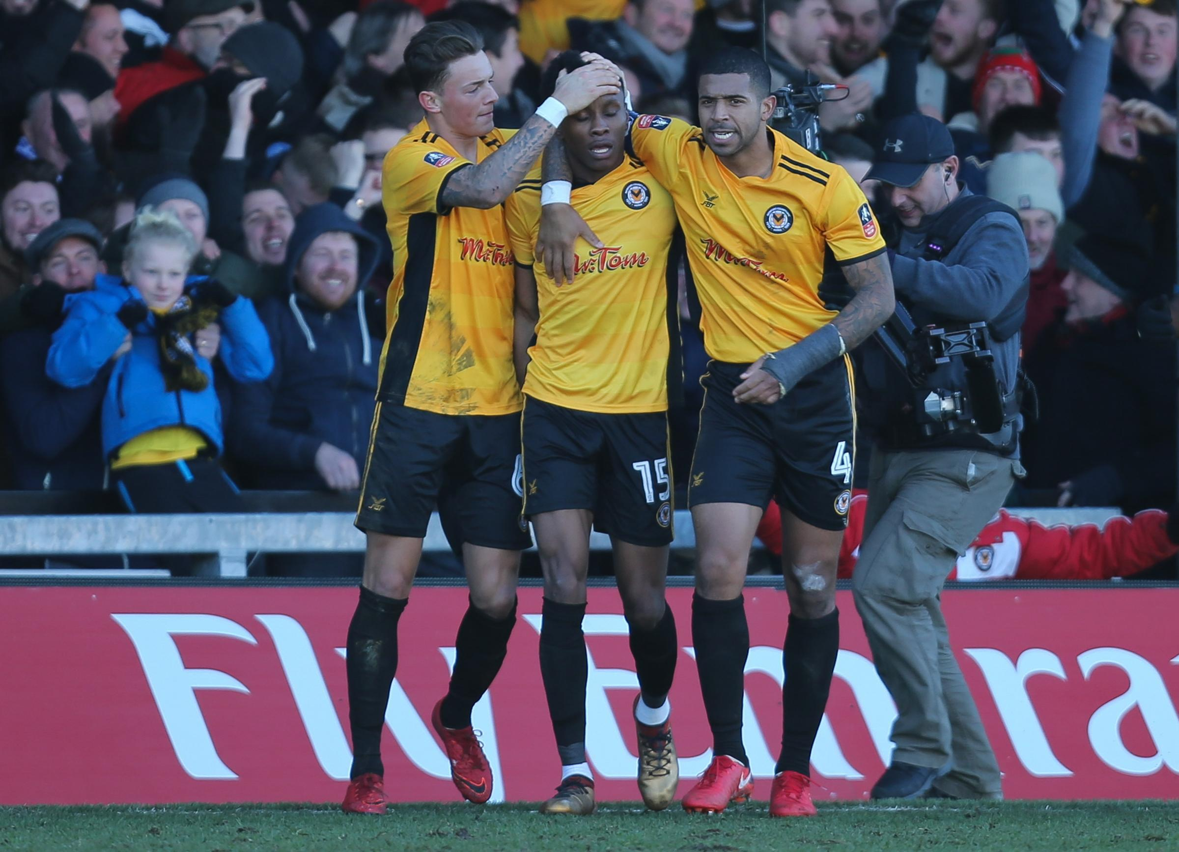 HERO: Newport County striker Shawn McCoulsky, centre, is congratulated by teammates Ben White and Joss Labadie after his winner against Leeds United. Picture: Huw Evans Agency