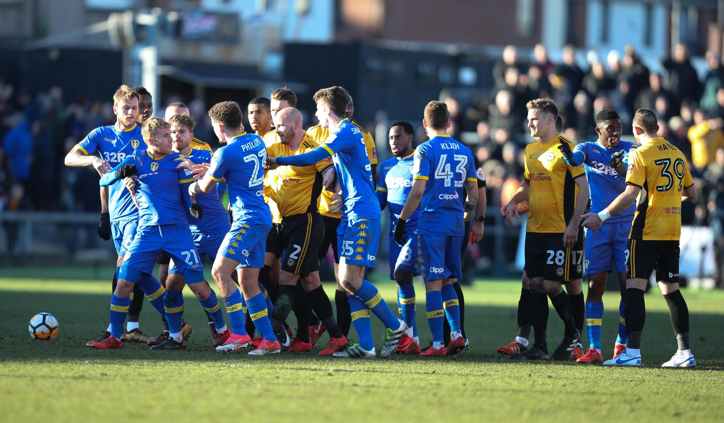 FLASHPOINT: The red card shown to Leeds United's Samuel Saiz, second from left, prompted a confrontation with Newport County players. Picture: Huw Evans Agency