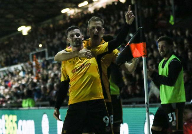 GOAL: Padraig Amond celebrates with Mickey Demetriou after putting Newport County 1-0 up against Tottneham Hotspur. Pictures: Huw Evans Agency