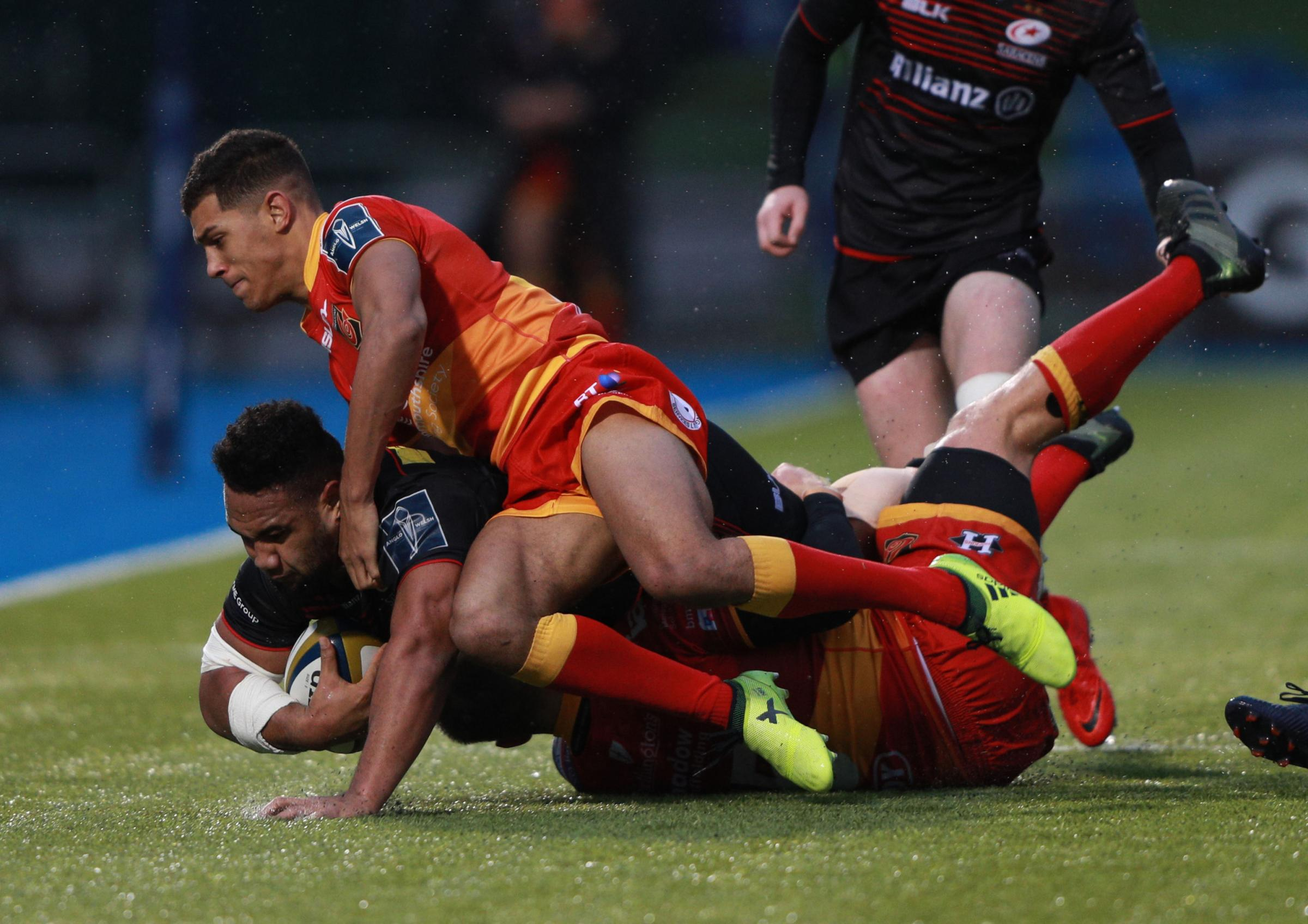 IN THE THICK OF IT: Rio Dyer makes a tackle on his Dragons debut at Saracens