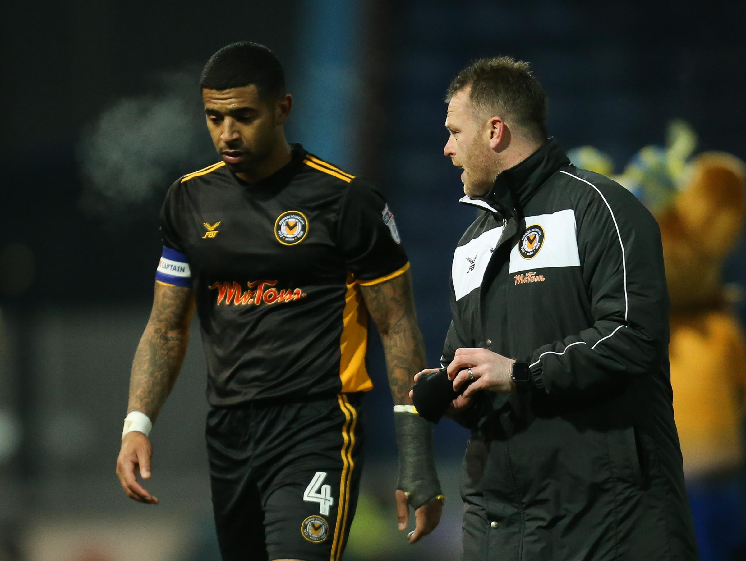 GUTTED: Newport County captain Joss Labadie, left, and manager Michael Flynn after the 5-0 defeat at Mansfield Town. Pictures: Huw Evans Agency