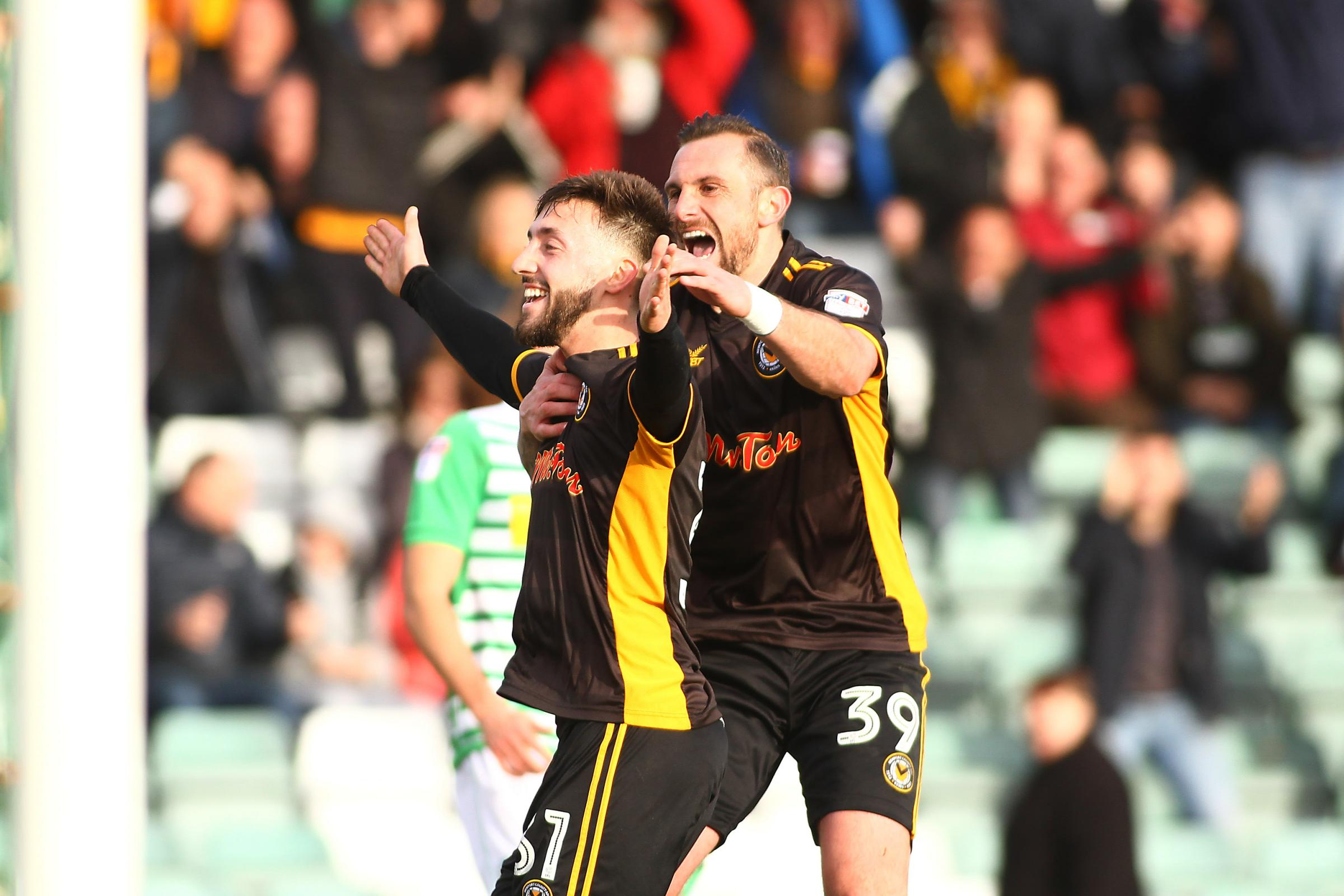 GOAL: Josh Sheehan celebrates his goal at Yeovil Town with Newport County teammate Paul Hayes. Picture: Huw Evans Agency