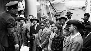 WELCOME: Jamaican immigrants are greeted by RAF officials from the Colonial Office, after arriving on the Empire Windrush in June 1948. Photo - PA Wire